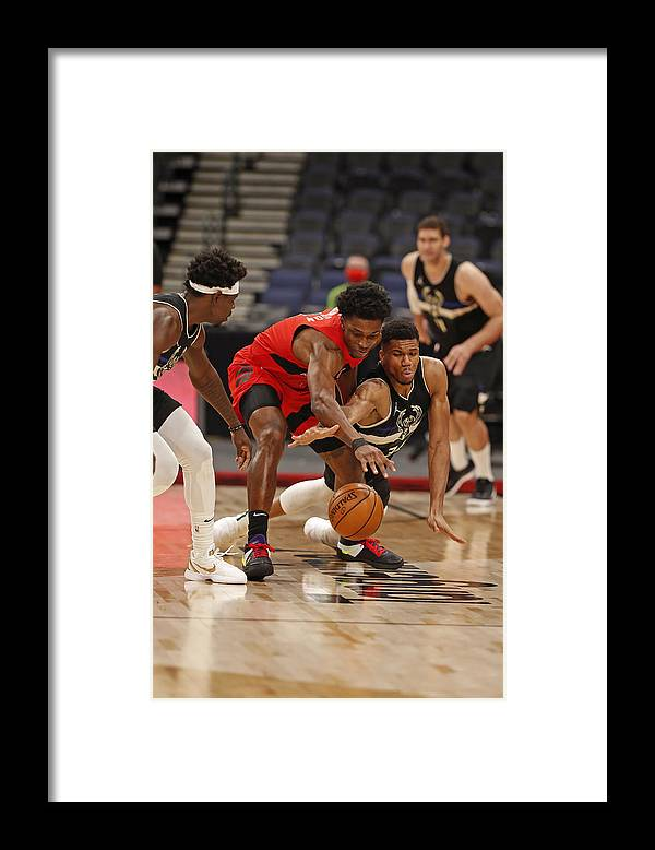 Nba Pro Basketball Framed Print featuring the photograph Giannis Antetokounmpo and Stanley Johnson by Scott Audette