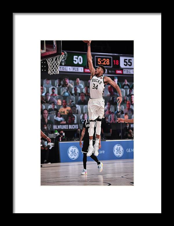 Nba Pro Basketball Framed Print featuring the photograph Giannis Antetokounmpo by David Dow