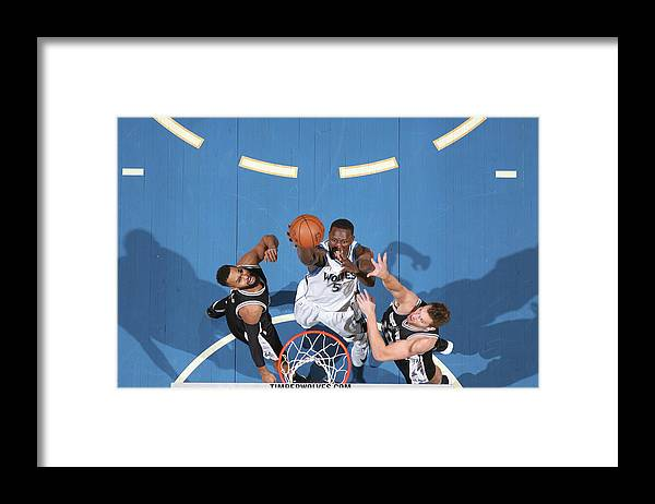 Nba Pro Basketball Framed Print featuring the photograph Gorgui Dieng by David Sherman