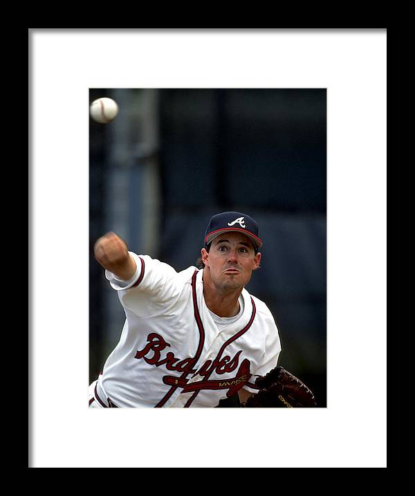Baseball Pitcher Framed Print featuring the photograph Greg Maddux by Ronald C. Modra/sports Imagery