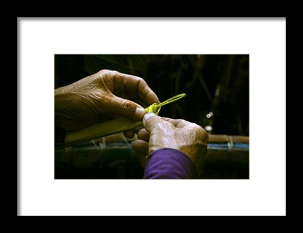 People Framed Print featuring the photograph Hands form a palm leaf into a small work of art by Bernd Schunack