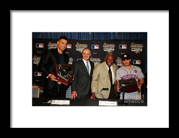 Game Two Framed Print featuring the photograph Hank Aaron and Giancarlo Stanton by Tim Bradbury
