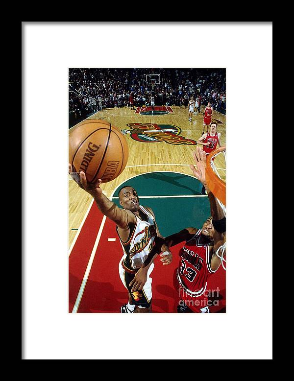 Nba Pro Basketball Framed Print featuring the photograph Hersey Hawkins and Scottie Pippen by Andrew D. Bernstein