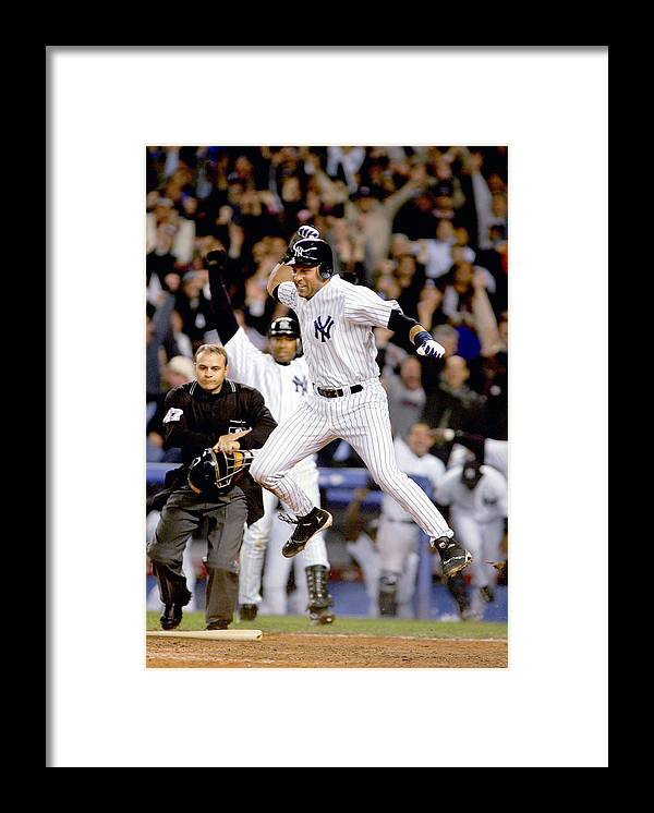 Game Two Framed Print featuring the photograph Hideki Matsui and Derek Jeter by Al Bello