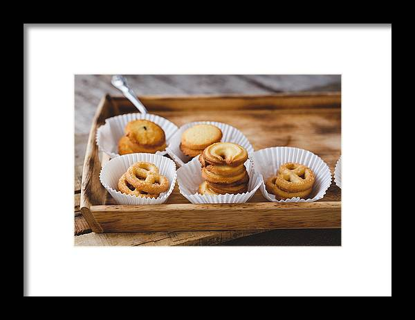Sugar Framed Print featuring the photograph High Angle View Of Cookies In Tray On Table by Thu Thai Thanh / EyeEm