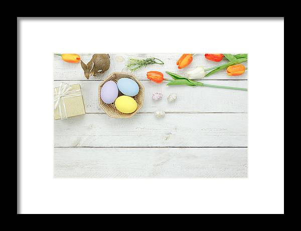 Easter Bunny Framed Print featuring the photograph High Angle View Of Easter Eggs In Bowl On Table by Chattrawutt Hanjukkam / EyeEm