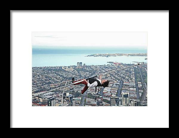 Artist Framed Print featuring the photograph High-wire Artist Kane Petersen Performs Tightrope Walk Over Melbourne CBD by Scott Barbour