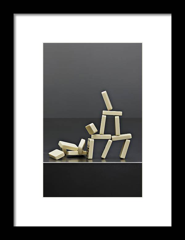 Risk Framed Print featuring the photograph House Dominos Falling by David Muir