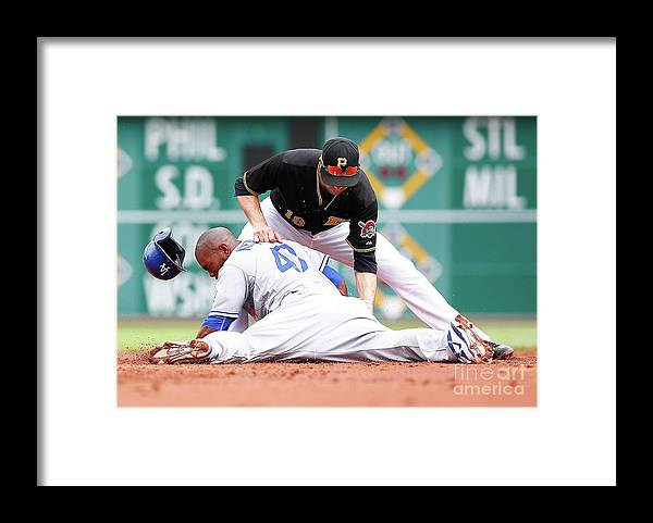 Second Inning Framed Print featuring the photograph Howie Kendrick and Neil Walker by Jared Wickerham