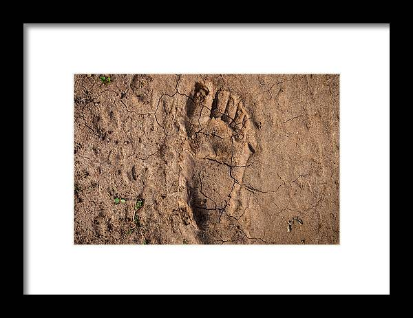 Famine Framed Print featuring the photograph Human footprint in the East-African desert (Malawi) by Guido Dingemans, De Eindredactie