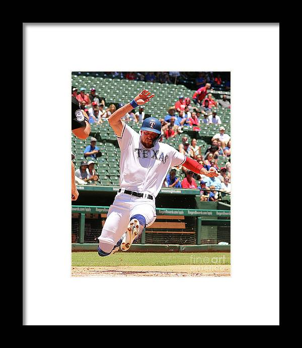 People Framed Print featuring the photograph Hunter Pence And Asdrubal Cabrera by Richard Rodriguez