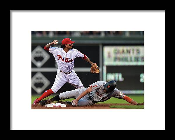 Double Play Framed Print featuring the photograph Hunter Pence and Freddy Galvis by Drew Hallowell