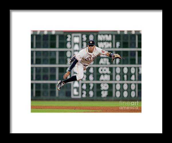 People Framed Print featuring the photograph Ian Desmond and Carlos Correa by Bob Levey