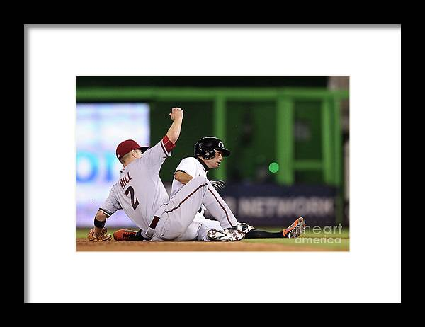 People Framed Print featuring the photograph Ichiro Suzuki and Aaron Hill by Rob Foldy