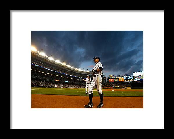 American League Baseball Framed Print featuring the photograph Ichiro Suzuki by Mike Stobe