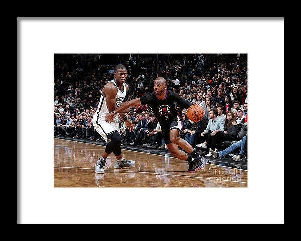 Nba Pro Basketball Framed Print featuring the photograph Isaiah Whitehead and Chris Paul by Nathaniel S. Butler