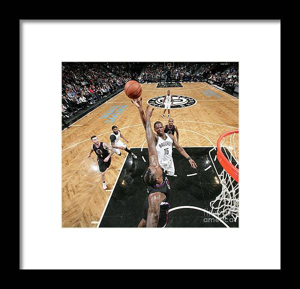 Nba Pro Basketball Framed Print featuring the photograph Isaiah Whitehead and Deandre Jordan by Nathaniel S. Butler