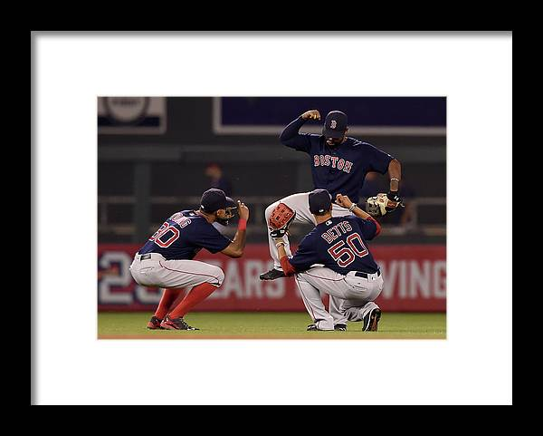 People Framed Print featuring the photograph Jackie Bradley, Chris Young, and Mookie Betts by Hannah Foslien