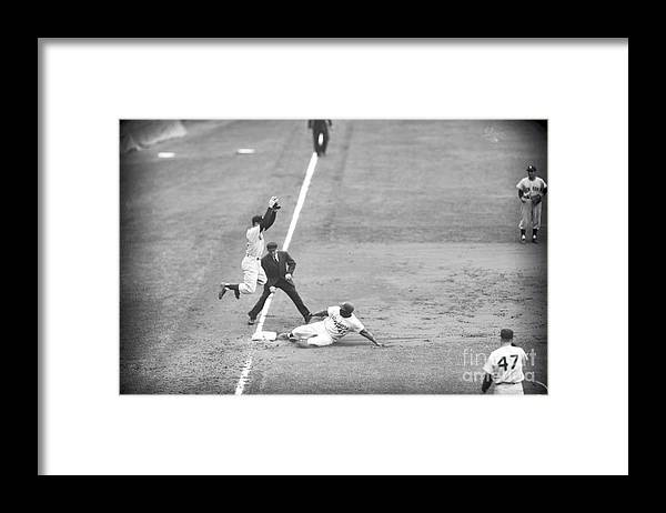 1950-1959 Framed Print featuring the photograph Jackie Robinson And Gil Mcdougald by Kidwiler Collection