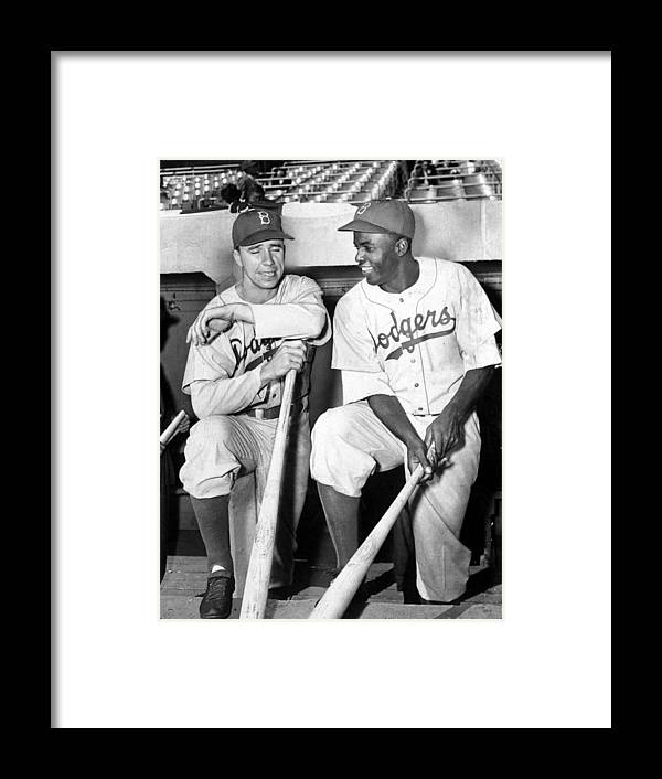 American League Baseball Framed Print featuring the photograph Jackie Robinson and Pee Wee Reese by New York Daily News Archive