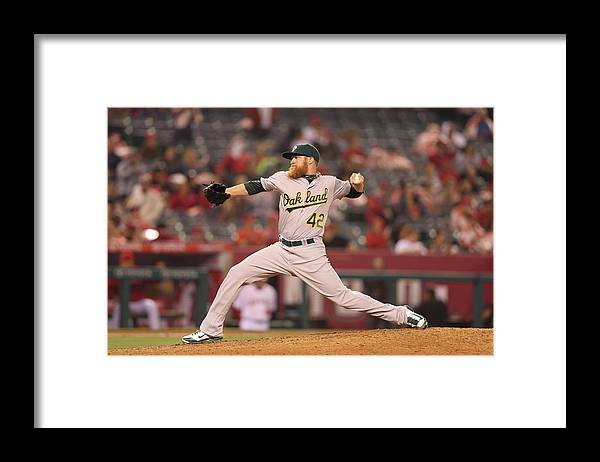American League Baseball Framed Print featuring the photograph Jackie Robinson by Paul Spinelli