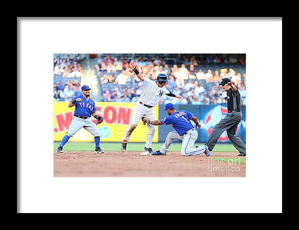 People Framed Print featuring the photograph Jacoby Ellsbury and Elvis Andrus by Mike Stobe