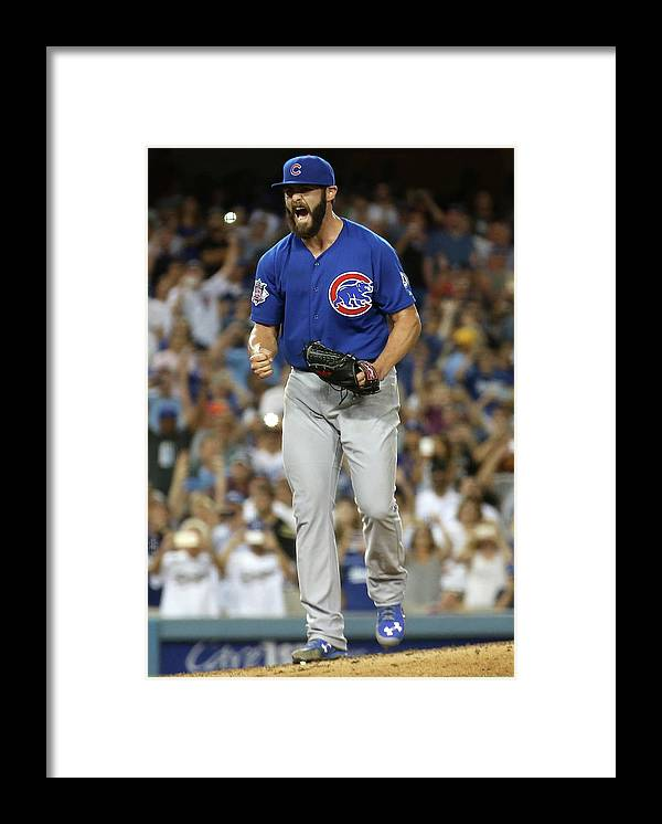 People Framed Print featuring the photograph Jake Arrieta by Stephen Dunn