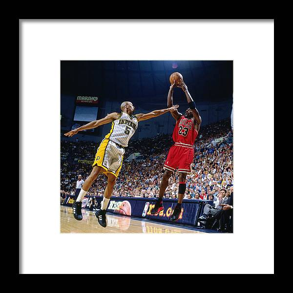 Chicago Bulls Framed Print featuring the photograph Jalen Rose and Michael Jordan by Nathaniel S. Butler