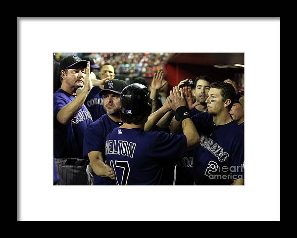 Scoring Framed Print featuring the photograph Jason Giambi, Todd Helton, and Troy Tulowitzki by Christian Petersen