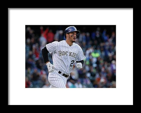 Three Quarter Length Framed Print featuring the photograph Jean Machi And Nolan Arenado by Doug Pensinger