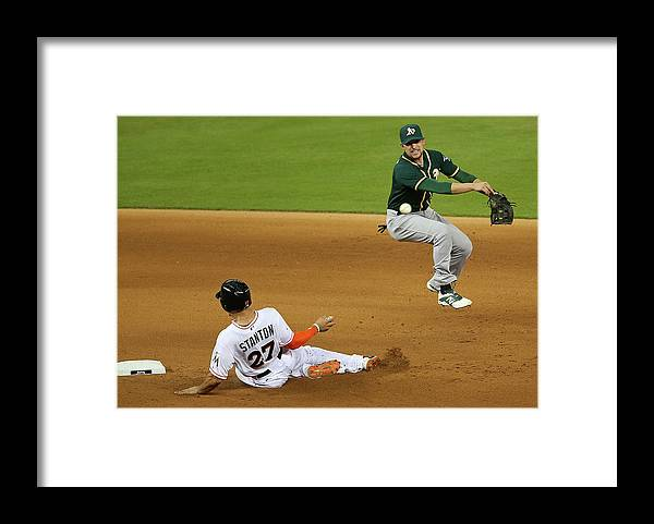 Double Play Framed Print featuring the photograph Jed Lowrie and Giancarlo Stanton by Mike Ehrmann