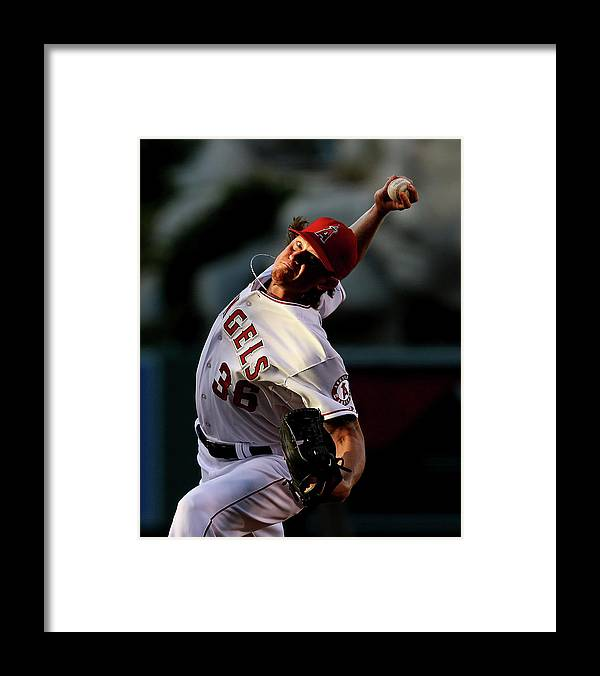 American League Baseball Framed Print featuring the photograph Jered Weaver by Stephen Dunn