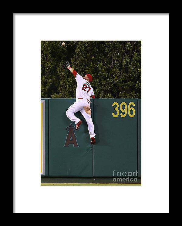 People Framed Print featuring the photograph Jesus Montero and Mike Trout by Stephen Dunn