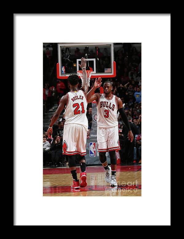 Chicago Bulls Framed Print featuring the photograph Jimmy Butler and Dwyane Wade by Gary Dineen