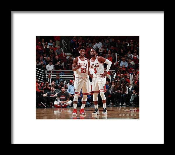 Nba Pro Basketball Framed Print featuring the photograph Jimmy Butler and Dwyane Wade by Jeff Haynes