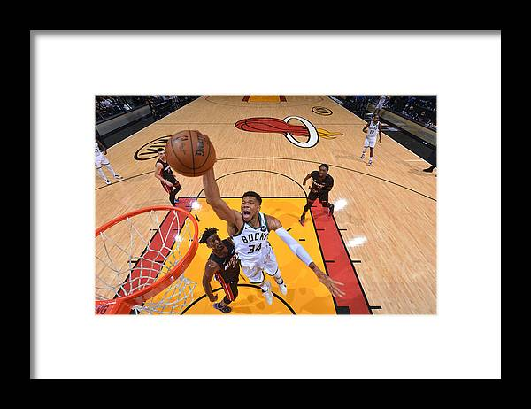 Playoffs Framed Print featuring the photograph Jimmy Butler and Giannis Antetokounmpo by Jesse D. Garrabrant