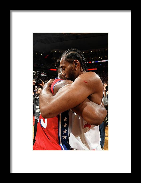 Playoffs Framed Print featuring the photograph Jimmy Butler and Kawhi Leonard by Ron Turenne