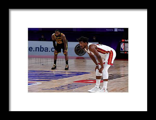 Playoffs Framed Print featuring the photograph Jimmy Butler and Lebron James by Andrew D. Bernstein