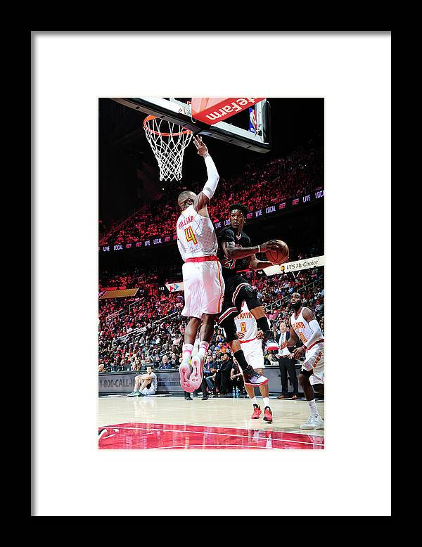 Atlanta Framed Print featuring the photograph Jimmy Butler and Paul Millsap by Scott Cunningham