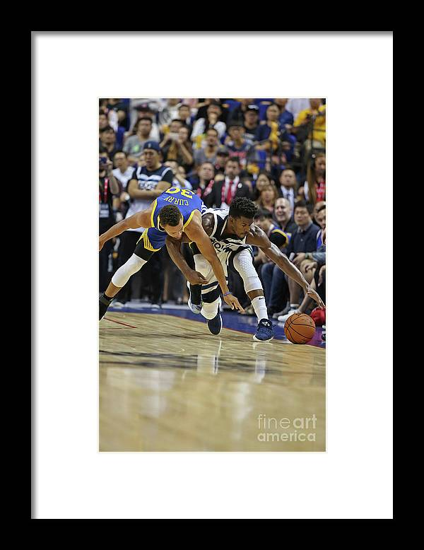 Event Framed Print featuring the photograph Jimmy Butler and Stephen Curry by David Sherman