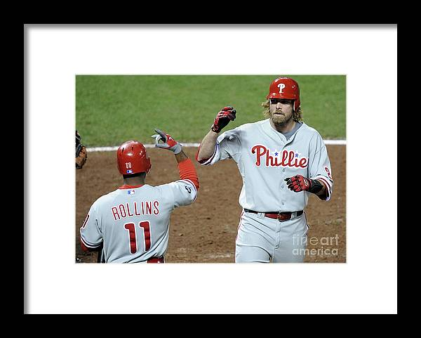 Playoffs Framed Print featuring the photograph Jimmy Rollins and Jayson Werth by Harry How