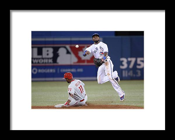American League Baseball Framed Print featuring the photograph Jimmy Rollins and Jose Reyes by Tom Szczerbowski