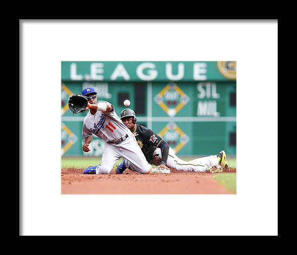 People Framed Print featuring the photograph Jimmy Rollins And Starling Marte by Jared Wickerham