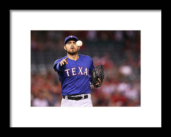 Ninth Inning Framed Print featuring the photograph Joakim Soria and Mike Trout by Stephen Dunn