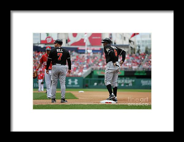 American League Baseball Framed Print featuring the photograph Joe Dimaggio and Juan Pierre by Jonathan Ernst