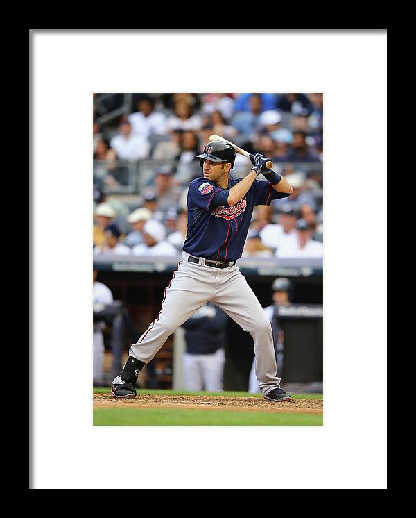 Joe Mauer Framed Print featuring the photograph Joe Mauer by Al Bello