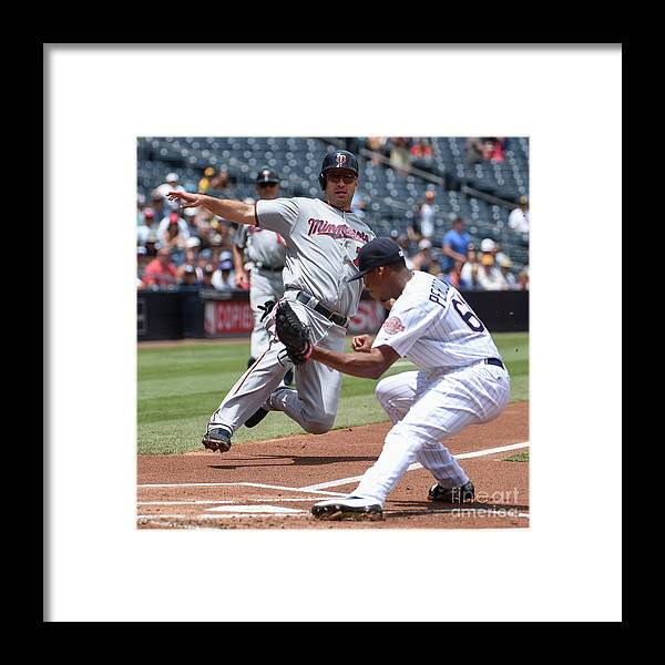 Joe Mauer Framed Print featuring the photograph Joe Mauer and Luis Perdomo by Denis Poroy