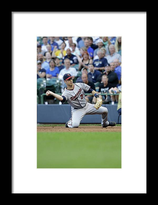 Joe Mauer Framed Print featuring the photograph Joe Mauer and Lyle Overbay by Mike Mcginnis