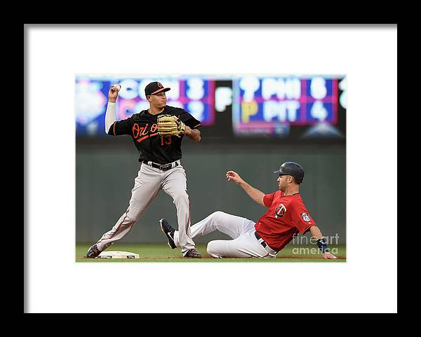 Double Play Framed Print featuring the photograph Joe Mauer and Manny Machado by Hannah Foslien