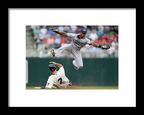 Joe Mauer Framed Print featuring the photograph Joe Mauer and Tim Beckham by Hannah Foslien